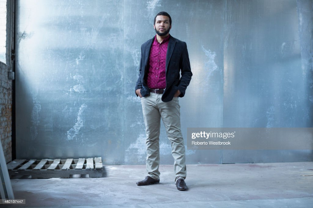 Mixed race businessman standing in warehouse