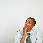 Mixed Race businessman thinking