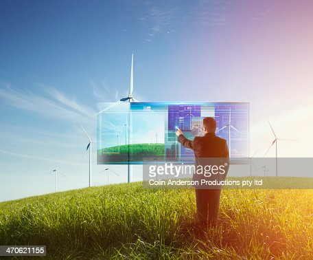 Mixed race businessman using touch screen computer outdoors : Stock Photo
