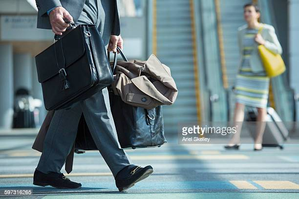Mixed race businessman walking in airport