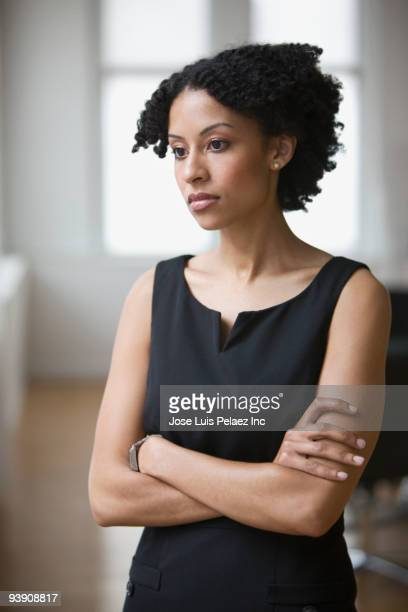 Mixed race businesswoman looking disappointed