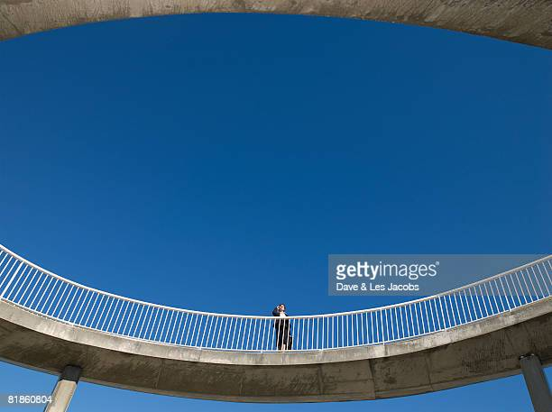 Mixed Race businesswoman on elevated walkway