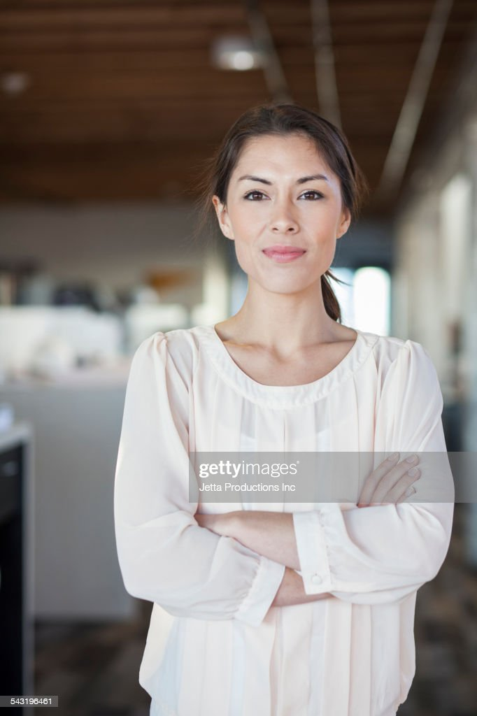 Mixed race businesswoman smiling in office : Stock-Foto