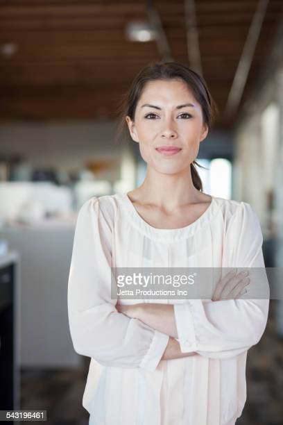 Mixed race businesswoman smiling in office