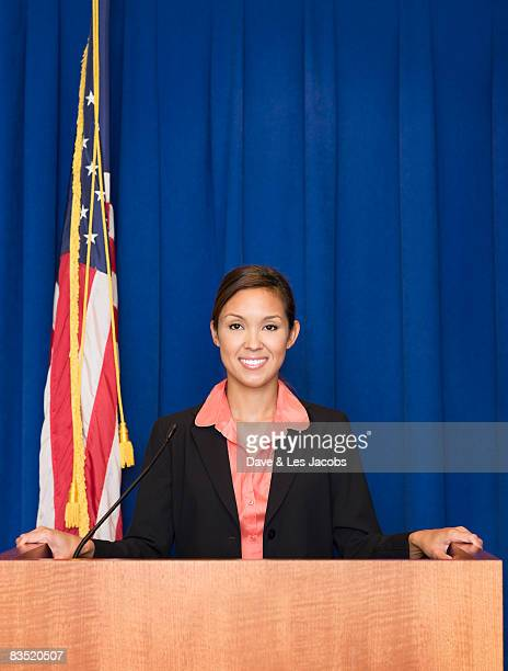 Mixed race businesswoman standing at podium