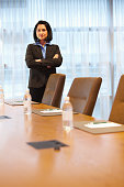 Mixed race businesswoman standing in conference room