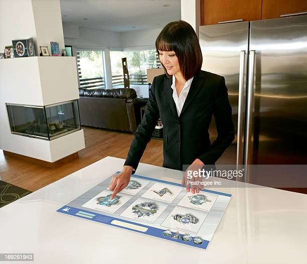 Mixed race businesswoman using computer in table