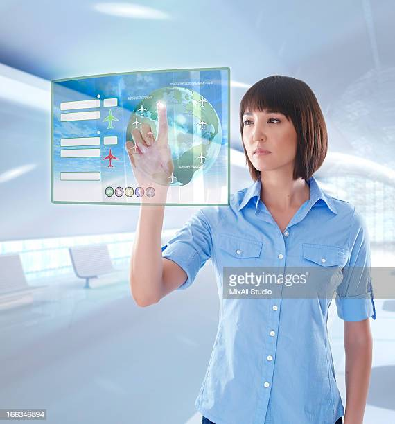 Mixed race businesswoman using digital display