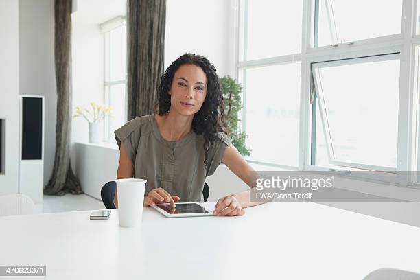 Mixed race businesswoman using digital tablet
