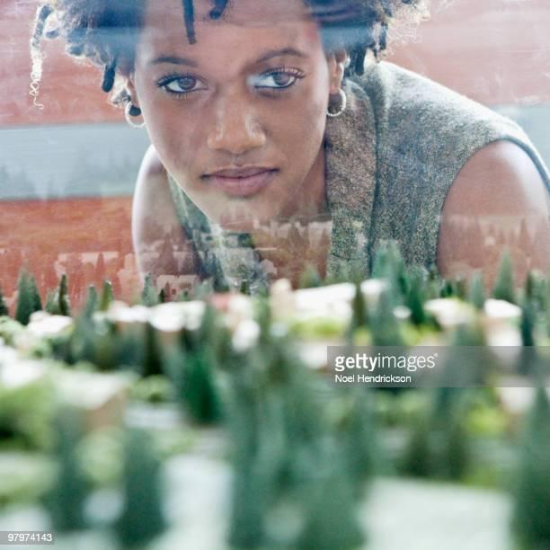 Mixed race businesswoman viewing development model