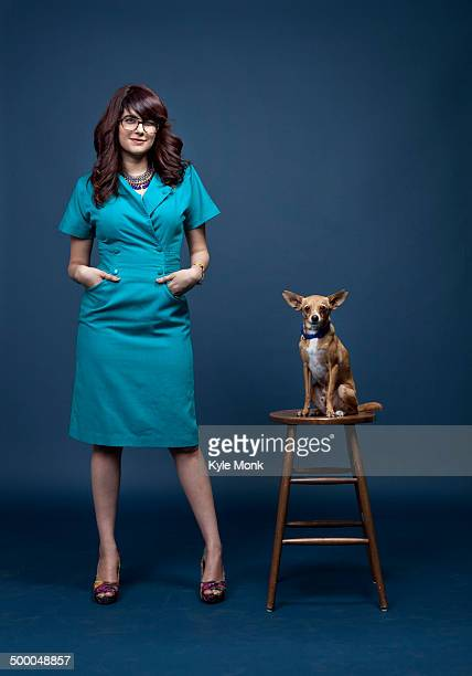 Mixed race businesswoman with dog on pedestal