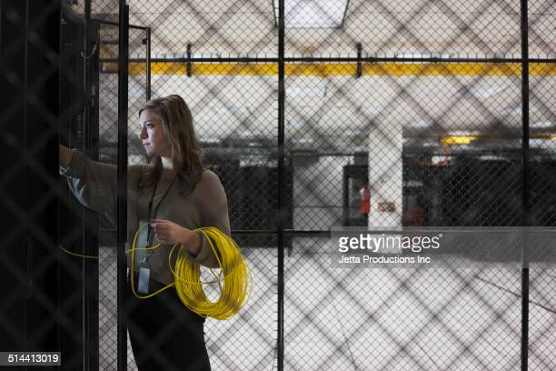 Mixed race businesswoman working in server room