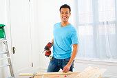 Mixed race carpenter holding power drill