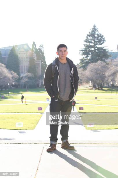 Mixed race college student smiling on campus