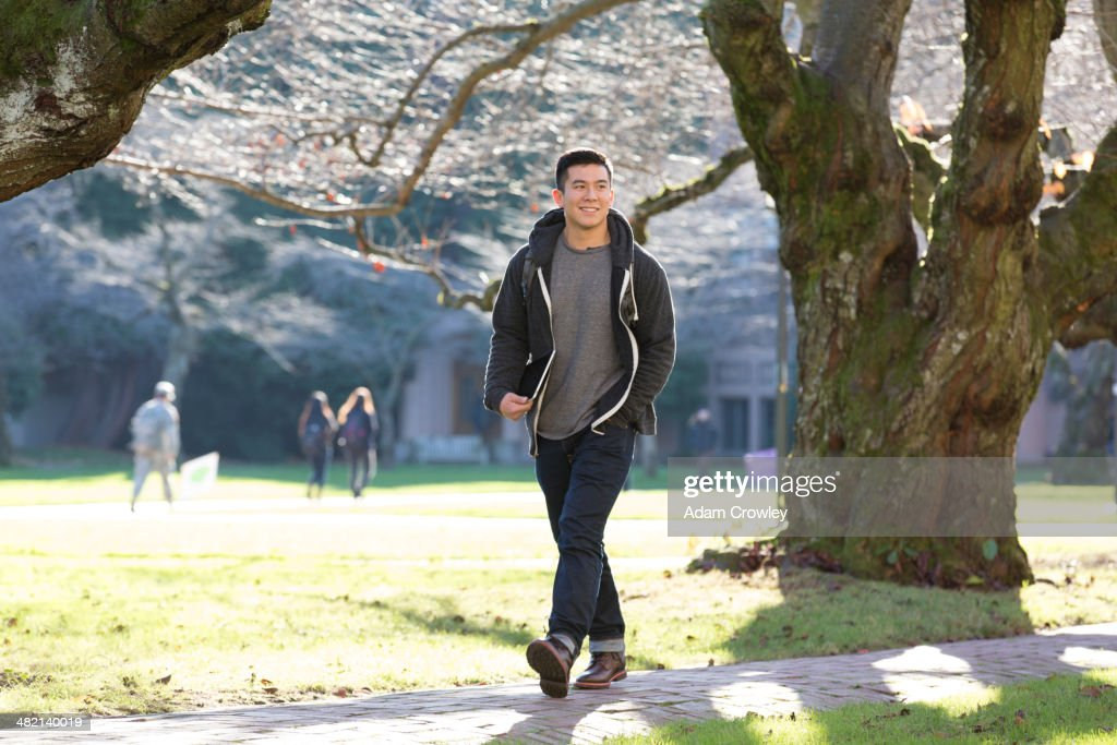 Mixed race college student walking on campus