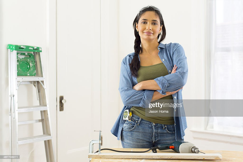 Mixed race contractor working in shop