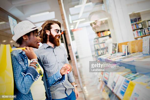 Mixed race couple looking at shop window
