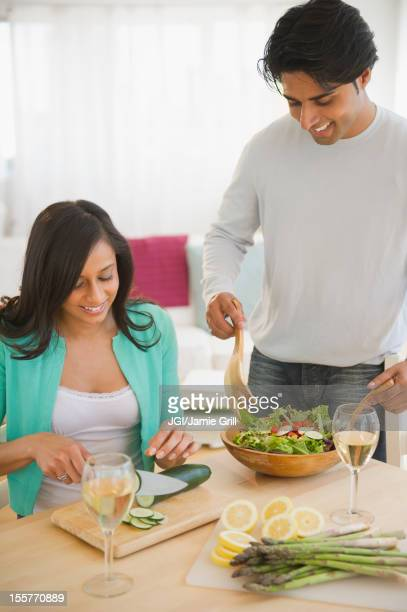 Mixed race couple preparing salad