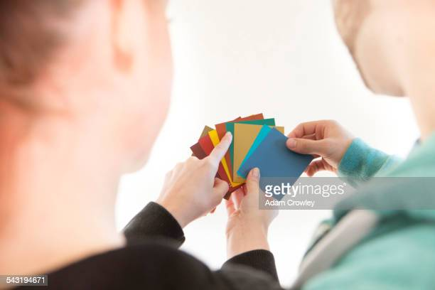 Mixed race couple selecting color swatches