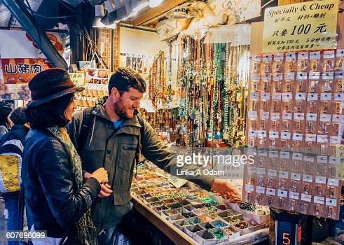 Mixed race couple shopping open air Asian Market