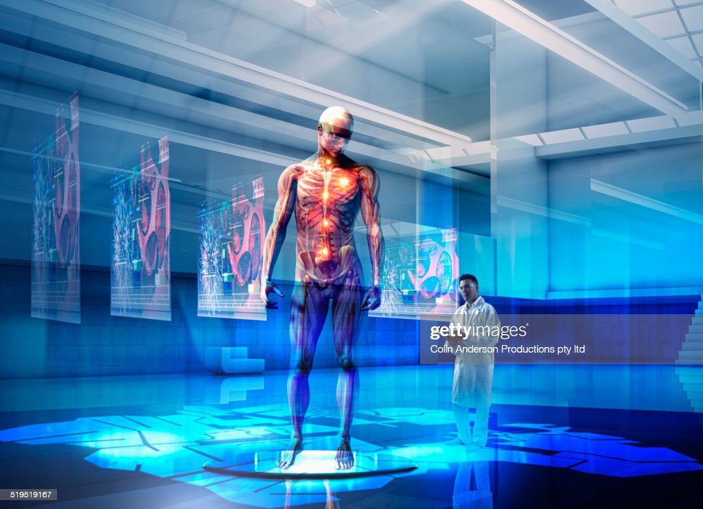 Mixed race doctor examining hologram of human anatomy