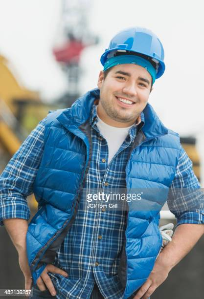 Mixed race engineer smiling at construction site