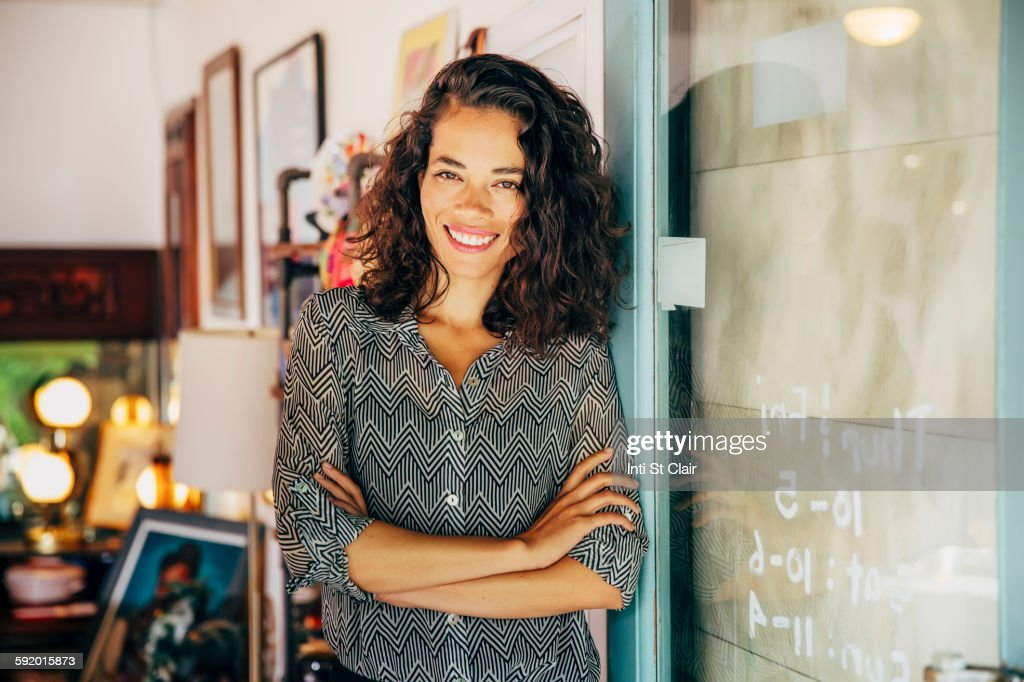 Mixed race entrepreneur standing in store
