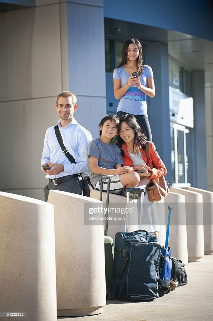 Mixed race family at airport between flights : Stock Photo