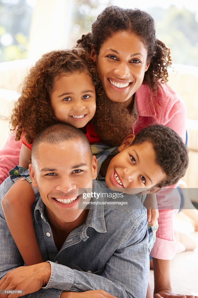 Mixed race family at home : Stock Photo