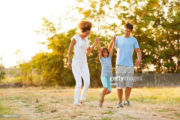 Mixed Race Family Enjoy Walking Outdoors