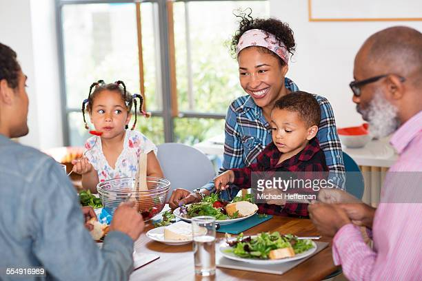 Mixed race family having lunch