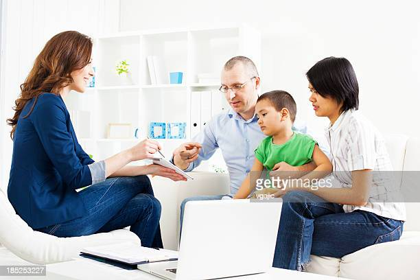 Mixed Race Family Meeting With Financial Advisor