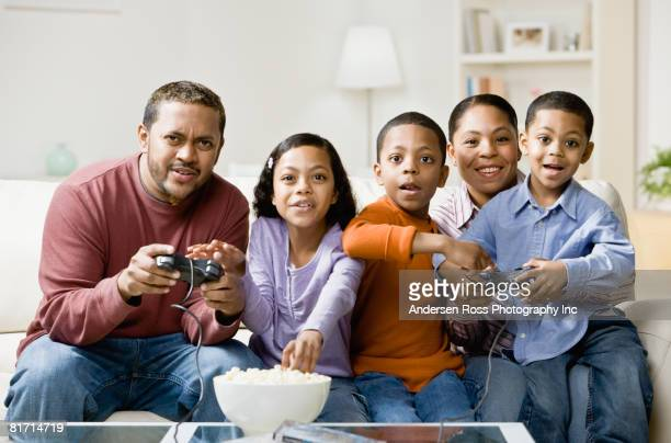 Mixed Race family playing video games