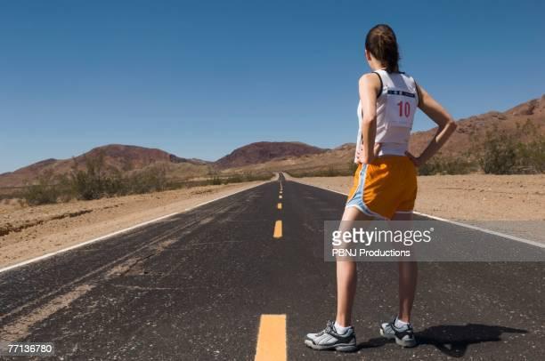 Mixed Race female runner on road