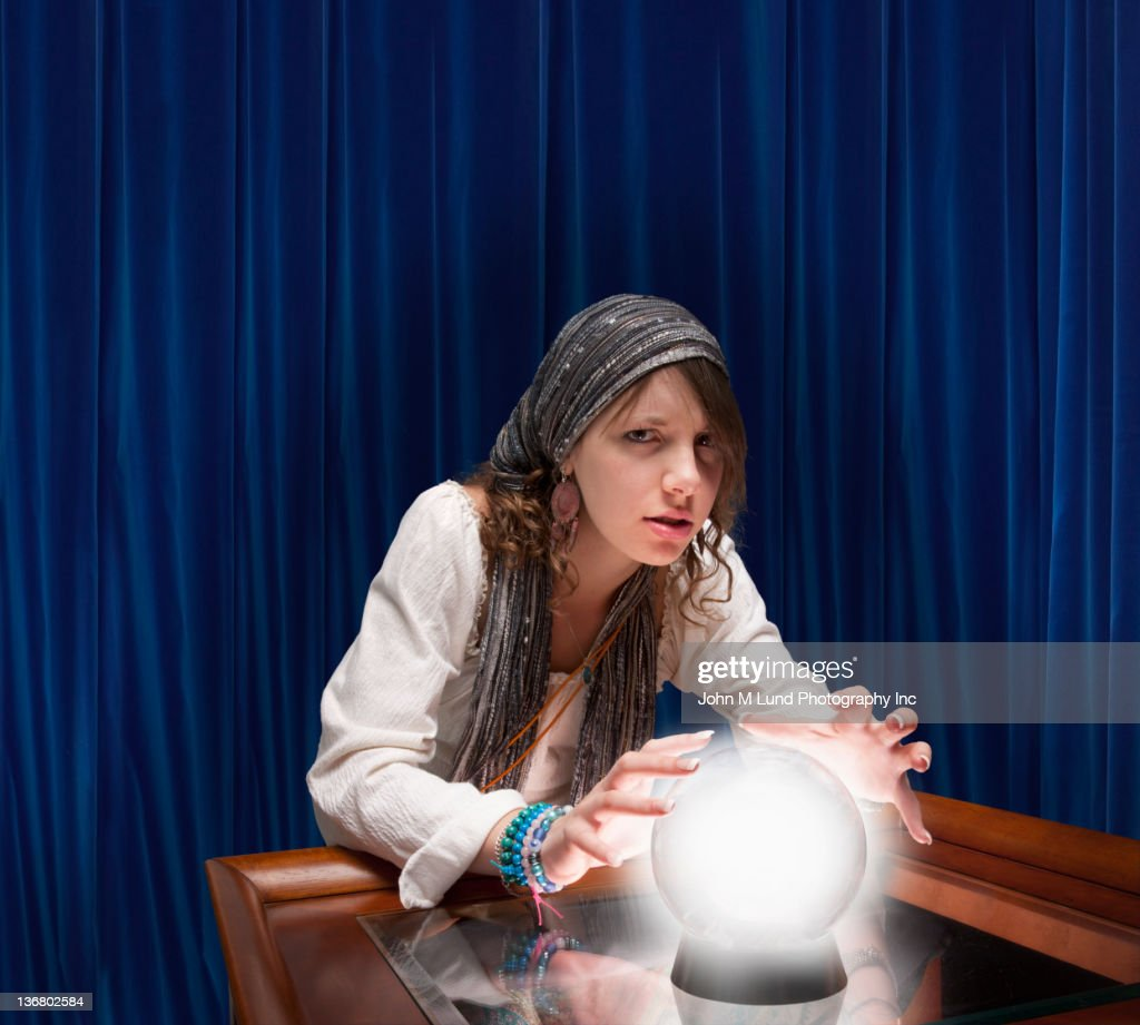 Mixed race fortune teller with crystal ball : Stock Photo