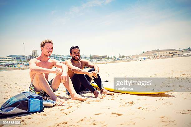 Mixed race friends with surfboard at Bondi Beach, Australia