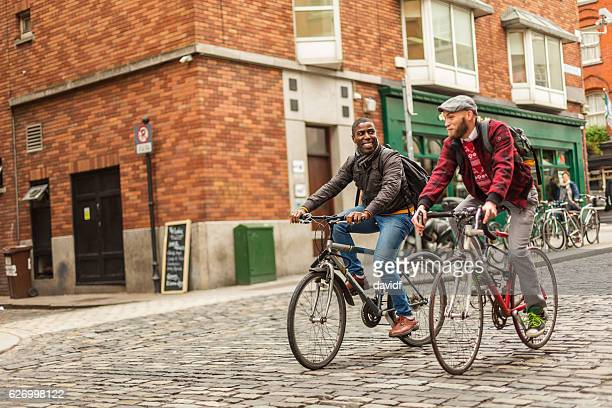 Mixed Race Gay Couple With Bicycles in the City