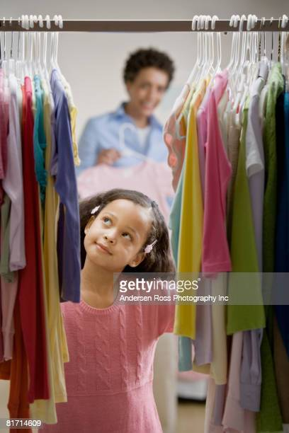 Mixed Race girl clothing shopping