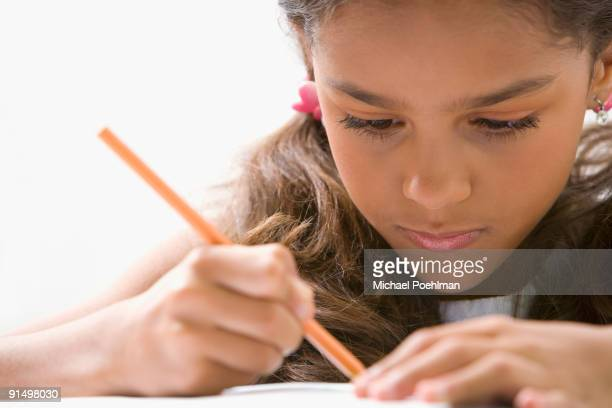 Mixed race girl doing homework