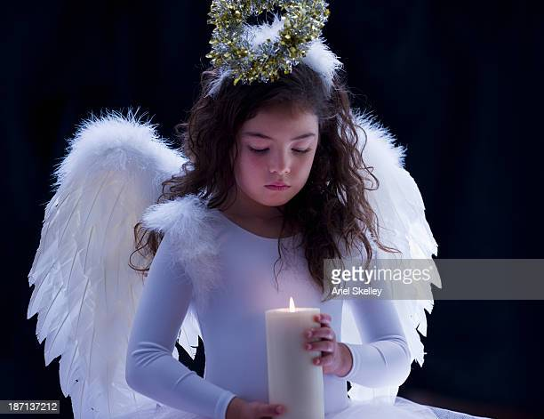 Mixed race girl dressed as an angel