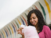 Mixed Race girl eating cotton candy