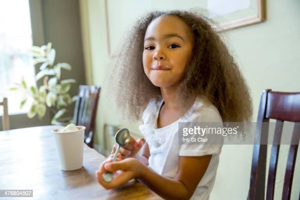 Mixed race girl enjoying hot chocolate