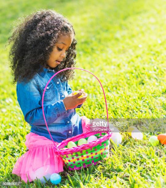 Mixed race girl hunting for Easter eggs