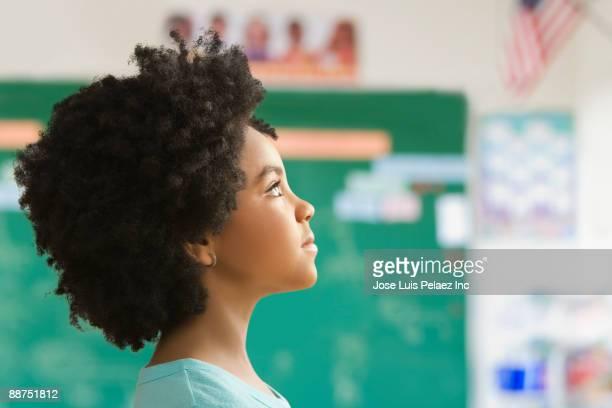 Mixed race girl in classroom