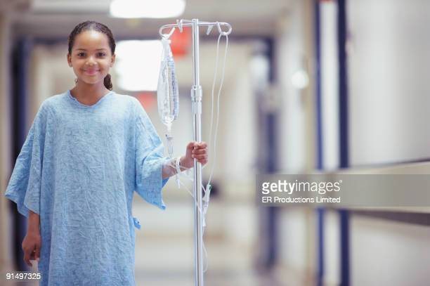 Mixed Race girl in hospital gown