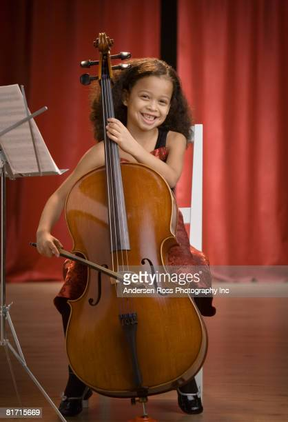 Mixed Race girl playing cello