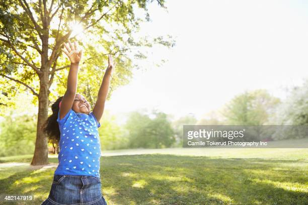 Mixed race girl playing in park