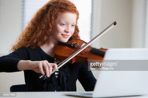 Mixed race girl playing violin