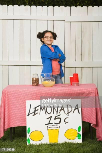 Mixed Race girl selling lemonade