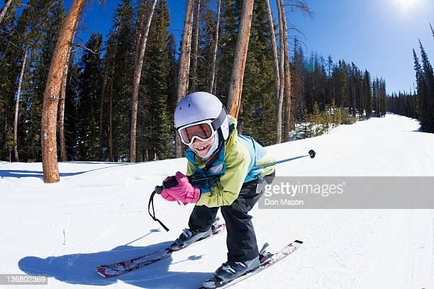 Mixed race girl skiing downhill
